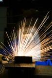 Worker with welding helmet welds steel Royalty Free Stock Photo