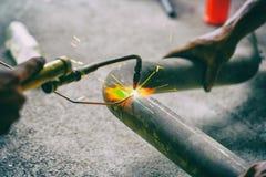 Worker welding joint steel exhaust pipe car. Worker welding joint steel exhaust pipe of the car Stock Photos