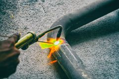 Worker welding joint steel exhaust pipe car. Worker welding joint steel exhaust pipe of the car Stock Photography