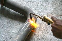 Worker welding joint steel exhaust pipe car. Worker welding joint steel exhaust pipe of the car Stock Image