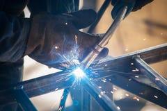 Worker welding metal Stock Photography
