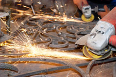 Worker welding metal. Production and construction. Worker welding metallic object . Production and construction Stock Photos