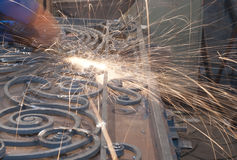 Worker welding metal. Production and construction. Worker welding metallic object . Production and construction Royalty Free Stock Image