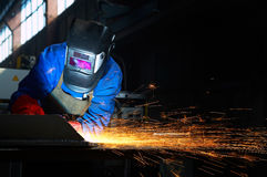 Worker welding metal and sparks Stock Photos