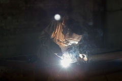 Worker welding metal with sparks at factory. Worker welding metal with sparks at factory Royalty Free Stock Photography