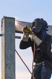 Worker welding parts of stell construction Stock Photo