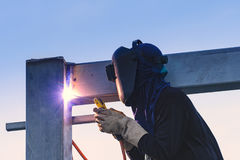 Worker welding parts of stell construction Royalty Free Stock Photography