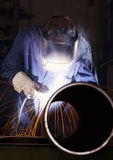 Worker Welding Pipe In Workshop. Stock Photos