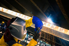 Worker welding for repair bottom side of container box Stock Photo
