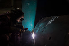 Worker welding repair spare part by SMAW process Stock Images