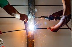 Worker welding steel bar. stock images