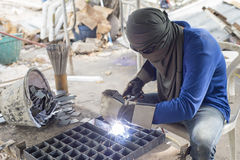 Worker welding steel. Royalty Free Stock Photo