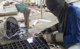 Worker welding steel. Stock Image