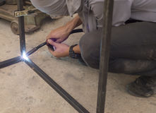 Worker welding steel in construction site. Royalty Free Stock Photos