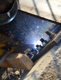 Worker welding steel Stock Image