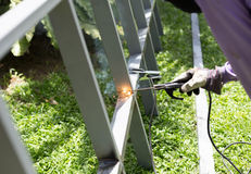 Worker welding a Steel Iron Bar for a New Fence Frame Royalty Free Stock Photo