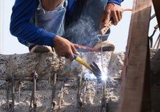 Worker welding steel metal Royalty Free Stock Photos