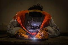 Worker welding the steel part Stock Photography