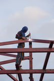 Worker welding the steel to build the roof. At construction site Royalty Free Stock Image