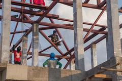 Worker welding the steel to build the roof. At construction site Stock Photography