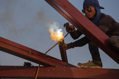 Worker welding the steel to build the roof Royalty Free Stock Image