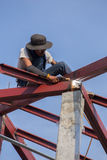 Worker welding the steel to build the roof Stock Image