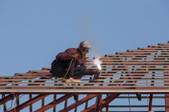 Worker welding the steel to build the roof. NAKHON RATCHASIMA -JAN 15 : worker welding the steel to build the roof at construction site on January 15, 2016 in Stock Images