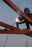Worker welding the steel to build the roof. NAKHON RATCHASIMA -JAN 13 : worker welding the steel to build the roof at construction site on January 13, 2016 in Stock Photos