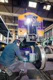 Worker welding train in the factory. Stock Photos