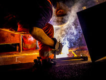 Worker welding train rail. Worker with protective mask and gloves welding train rail royalty free stock photos
