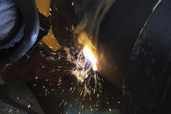 Worker welding tube. Stock Images