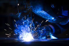 Worker welding using MIG/MAG. Stock Images