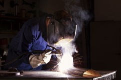 Worker welding in workshop. Stock Images