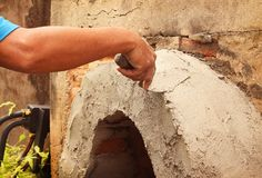 Worker were plastering with trowel putty knife on construction site stock image