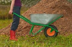 Worker with a wheelbarrow Stock Photos