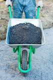 Worker with a wheelbarrow Royalty Free Stock Image