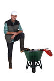 Worker with a wheelbarrow Royalty Free Stock Images