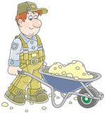 Worker with a wheelbarrow Royalty Free Stock Photos