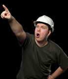 Worker in white helmet pointing to something Royalty Free Stock Photography