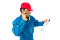 Worker who looks at a project. And talking on the phone Royalty Free Stock Image