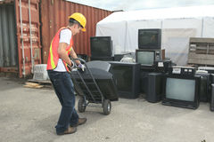 A worker who recycling thing on recycle center Stock Image