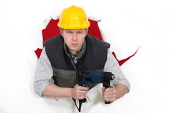 Worker wielding drill Royalty Free Stock Image