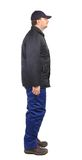 Worker in winter workwear. Side view. Royalty Free Stock Photo