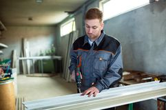 Worker With Drilling Mashine In Workshop Stock Image