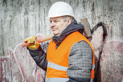 Worker With Sledge Hammer Near The Wall Royalty Free Stock Images