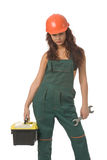 Worker woman. Beautiful woman in green coverall with screw key isolated on white Royalty Free Stock Image