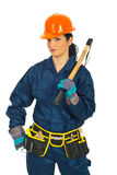 Worker woman with hatchet. Beauty worker woman in uniform holding hatchet isolated on white background Stock Image