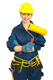 Worker woman holding paint roller Stock Image