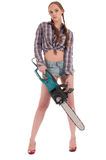 Worker woman in jeans coverall with chain saw Royalty Free Stock Photo