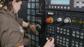 Worker woman looks at watch starts instrument operation stock video